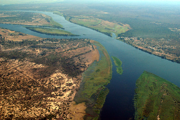 Aerial photo of the confluence of the Kwando (Chobe)     River (centre left) and the Zambezi River at Kazungula